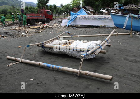 Self made fishing boat on the beach in the northwest of Bali - Stock Photo