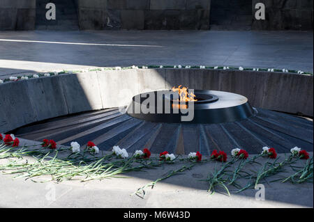 Eternal flame at the Tsitsernakaberd Armenian Genocide memorial complex in Yerevan,Armenia - Stock Photo
