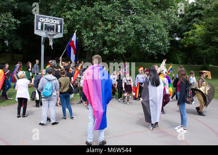 LGBT pride event in Hanley park,Stoke on Trent,Uk.24th June,2017.People taking part in pride parade. - Stock Photo