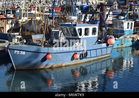 BLUE FISHING BOAT WITH RED MOORING BUOYS, REFLECTED IN OCTOBER SUNSHINE. AT CAMBER DOCKS, OLD PORTSMOUTH, UK - Stock Photo