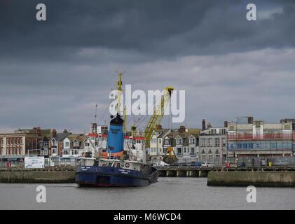 Dredging Lowestoft Harbour Suffolk - Stock Photo