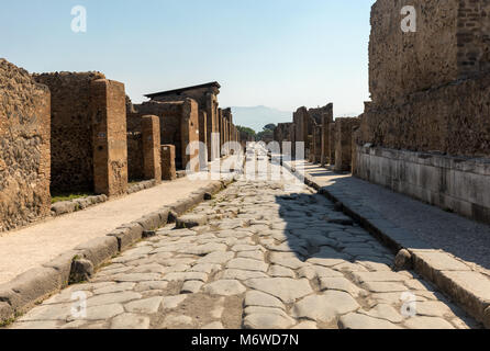 An ancient cobbled street in the ruins of Pompeii, Italy. - Stock Photo