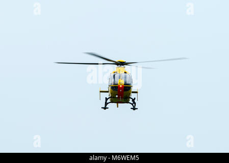 Yellow Airbus H145 Helicopter Electricity board - Stock Photo