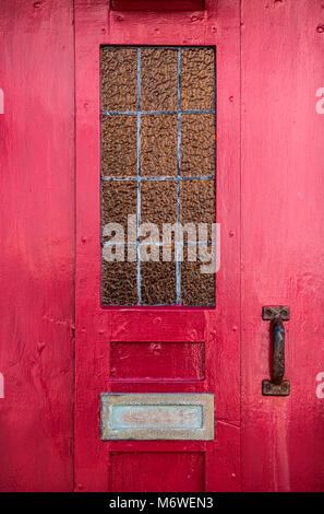 Detail of a red front door to a house - Stock Photo