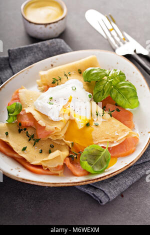 Savory crepes with salmon and poached egg - Stock Photo