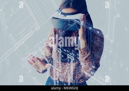 The woman with glasses of virtual reality. Future technology concept. Modern imaging technology - Stock Photo