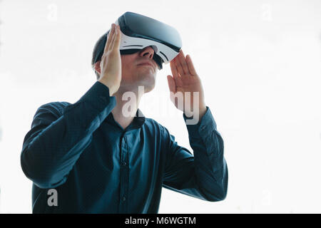 The man with glasses of virtual reality. Future technology concept. Modern imaging technology - Stock Photo