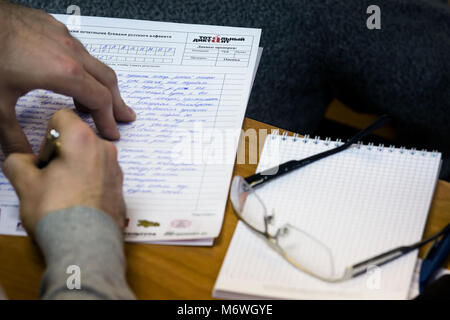 People write the text an annual international Russian language test, Totalny Diktant (Total Dictation) at Moscow - Stock Photo