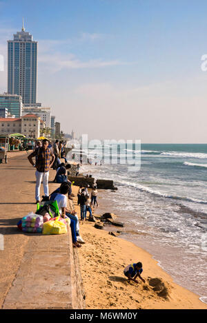 Vertical view of people relaxing on Galle Face beach in Colombo, Sri Lanka. - Stock Photo