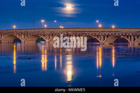 This is the picture of full moon over Houston street in Dallas over Trinity river. - Stock Photo