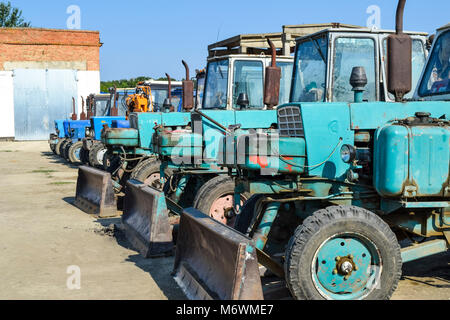 Tractor with a bucket for digging soil. Bulldozer and grader. - Stock Photo