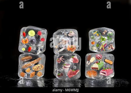 Concept of frozen products: fruits, vegetables, fishs, meat, spices herbs, pastry, were frozen inside ice cubes - Stock Photo