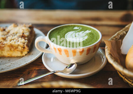 Close-up ceramic cup with green tea called Matcha - Stock Photo