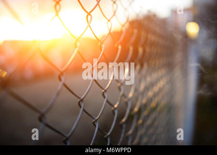 fence with metal grid in perspective, background - Stock Photo