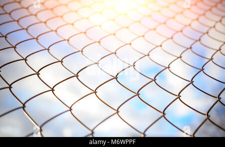Blue sky behind a metal grate, background - Stock Photo