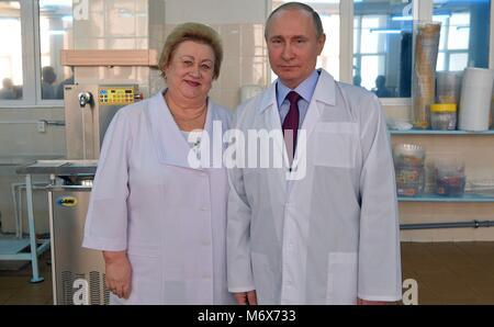 Samara, Russia. 07th Mar, 2018. Russian President Vladimir Putin poses with Samara bakery and confectionery complex - Stock Photo