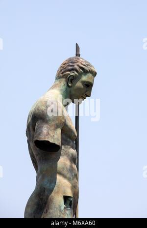 Pompeii, Italy - June 15, 2017: Sculptures of the Polish sculptor Igor Mitoraj on display at Pompeii archaeological - Stock Photo