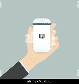 Hand holding smartphone with video player for website on the screen.Mobile applications isolated background.Mobile - Stock Photo