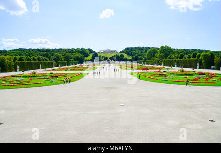 VIENNA,AUSTRIA - SEPTEMBER 4 2017; Tourists  between gardens on long path leading to Gloriette in landscaped grounds of Schonbrunn Imperial Palace