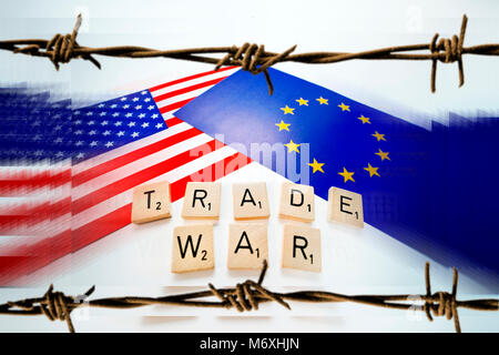 Letters forming the words trade and war in front of the flags of the USA and the EU - Stock Photo