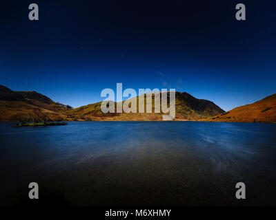 Moonlight over Mellbreak, Crummock Water, The Lake District, England. - Stock Photo