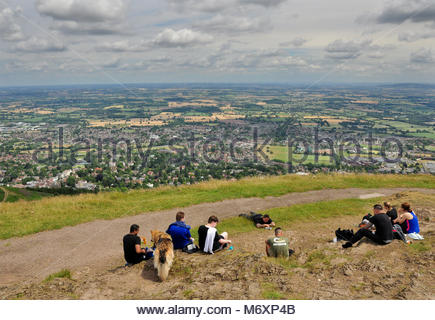People taking in the view over Great Malvern and Worcestershire from the summit of the Worcester Beacon, the highest - Stock Photo