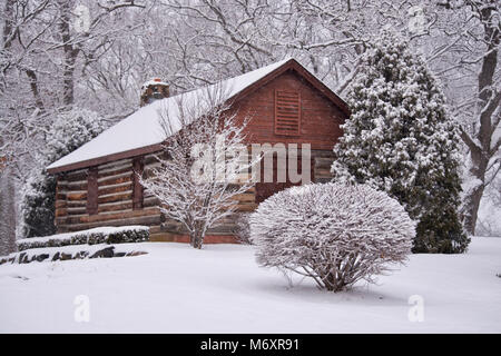 Snow Covered Log Cabin in Illinois. - Stock Photo