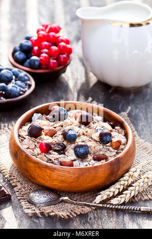 Healthy  breakfast with muesli and chocolate covered berries - Stock Photo