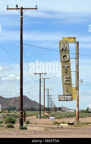 The faded sign for the now-demolished Henning Motel still stands along Route 66 in the Mojave Desert town of Newberry - Stock Photo