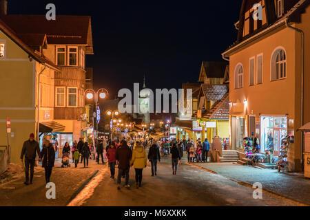 Karpacz, Poland -  February 2018 : Tourists walking on the main high street in Karpacz town, polish winter ski resort - Stock Photo