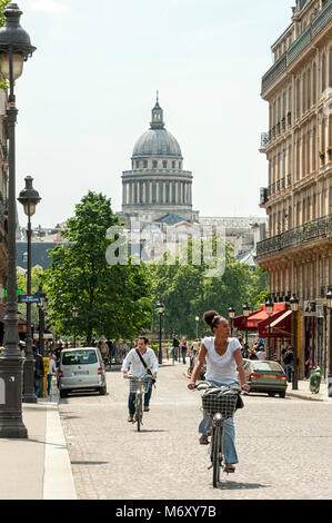 PARIS, FRANCE:  Cyclists on the Pont Louis-Phillipe with the dome of the Pantheon in the background - Stock Photo