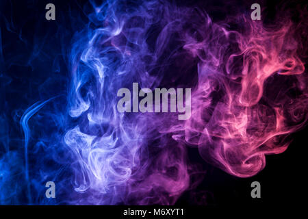 Thick colorful smoke of blue, purple on a black isolated background. Background from the smoke of vape - Stock Photo