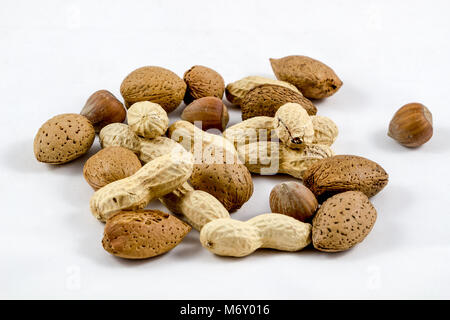 Healthy mix nuts on white background. Almonds, hazelnuts, peanuts - Stock Photo
