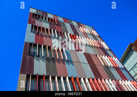 MILAN, ITALY, MARCH 28, 2017 - Exterior colorful of a modern office building in Milan, Italy - Stock Photo