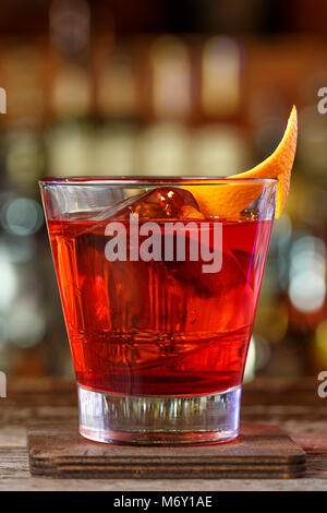 Negroni on the bar. Red tart cocktail is in the nightclub on the bar. Place for writing text - Stock Photo