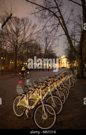 Bicycles in the Tiergarten at night, Berlin, Germany - Stock Photo