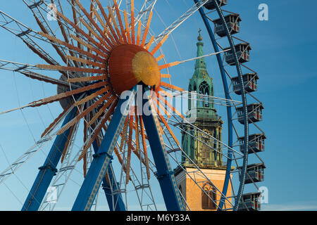 A ferris wheel at Neptunbrunnen with Marienkirche behind, Mitte, Berlin, Germany - Stock Photo