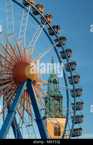 A ferris wheel at Neptunbrunnen with Marienkirche behind, Mitte, Berlin, Germany - Stock Photo