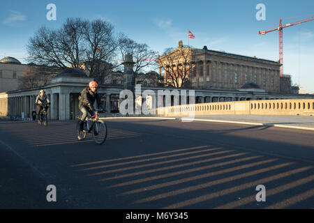 Cyclists crossing Friedrichsbrucke over the River Spree, Mitte, Berlin, Germany - Stock Photo