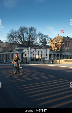 A cyclist crossing Friedrichsbrucke over the River Spree, Mitte, Berlin, Germany - Stock Photo