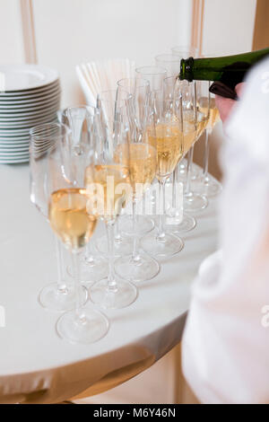 waiter pours champagne - Stock Photo