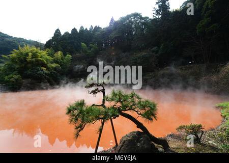 Chi-no-ike Jigoku ( Blood Pond) is the oldest Jigoku spring in Japan. - Stock Photo
