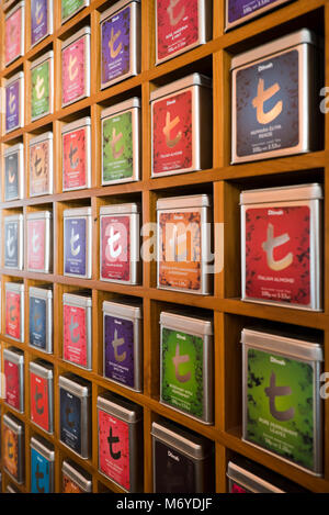 Vertical close up of rows of tea caddies at a tea shop in Colombo, Sri Lanka. - Stock Photo