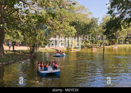 Horizontal view of people in pedaloes in Viharamahadevi Park, formerly known as Victoria Park in Colombo, Sri Lanka. - Stock Photo
