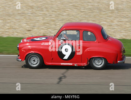 Motor Racing with an Austin motor car  at the Goodwood Revival meeting in 2004. - Stock Photo