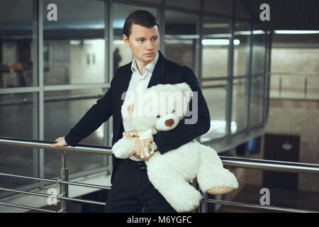 Portrait of a sad man with a toy. He is waiting for a meeting - Stock Photo