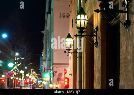 Night city view of downtown street with beautiful lanterns in Oslo, Norway - Stock Photo
