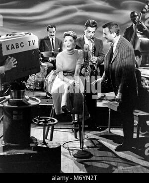 JULIE LONDON (1926-2000) American jazz singer and film actress on the American KABC TV show 'Stars of Jazz' in 1957