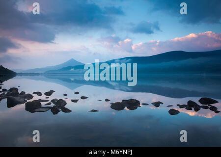 Schiehallion reflected in Loch Rannoch at dawn, Perthshire, Scotland, UK - Stock Photo