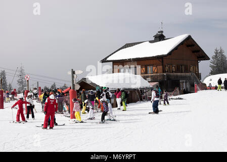 A Chalet Style Restaurant and Bar Facility with Chairlift Ticket Sales Office at Les Gets Ski Resort Haute Savoie - Stock Photo